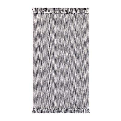 フリンジのついた平織りラグ